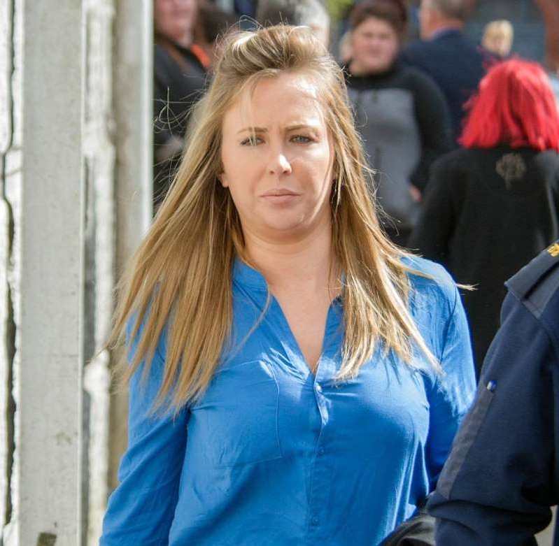 a woman in a blue shirt: Molly Sloyan leaving court