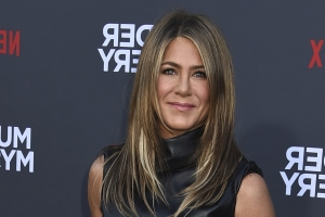 Jennifer Aniston Recalls 'Cringing' When Justin Theroux Made Her Watch Herself in Leprechaun
