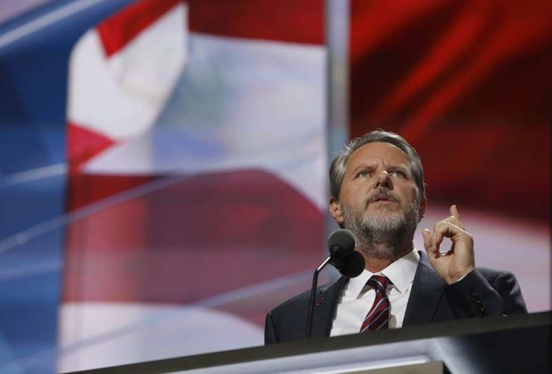 Jerry Falwell, Jr. wearing a suit and tie: Jerry Falwell Jr. speaks during the last day of the Republican National Convention on Thursday, July 21, 2016, at Quicken Loans Arena in Cleveland, Ohio.