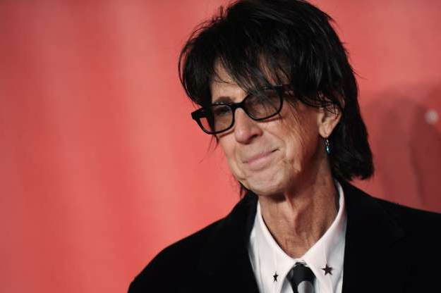 Slide 11 of 172: FILE - In this Feb. 6, 2015, file photo, Ric Ocasek of the Cars arrives at the MusiCares Person of the Year event at the Los Angeles Convention Center in Los Angeles. Ocasek, famed frontman for The Cars rock band, has been found dead in a New York City apartment. The New York City police department said officers responding to a 911 call found the 75-year-old Ocasek on Sunday, Sept. 15, 2019. (Photo by Richard Shotwell/Invision/AP, File)