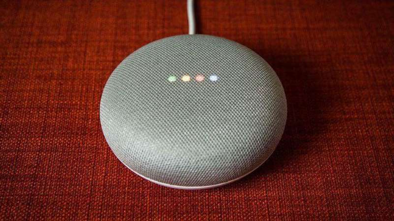 a close up of a red table: The lights may be on, but who's going to help troubleshoot when Google Assistant doesn't respond from your Google Home? Chris Monroe/CNET