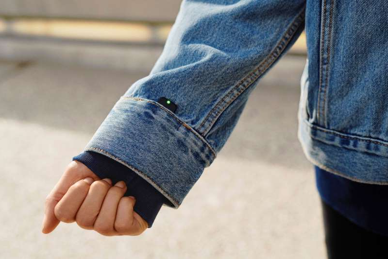 a close up of feet wearing blue shoes: Popular Science