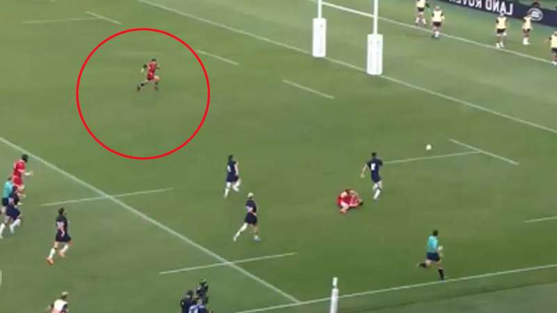 a group of people flying kites in a field: Hastings scored his second try against Russia in surprising style