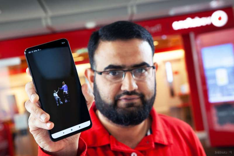 a man holding a phone and looking at the camera: Vodafone 5g The Phones The Speeds The Prices And Everything You Need To Know image 1