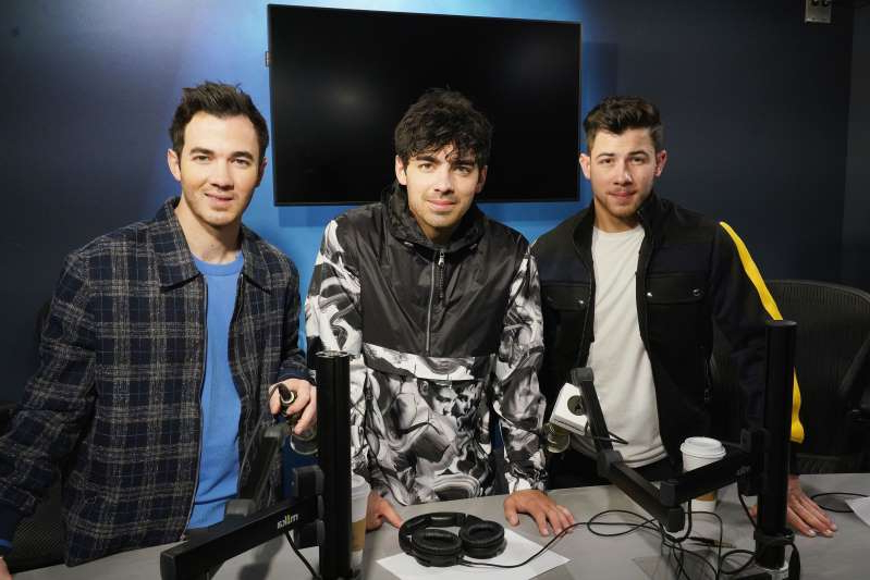 Nick Jonas, Joe Jonas, Kevin Jonas posing for the camera