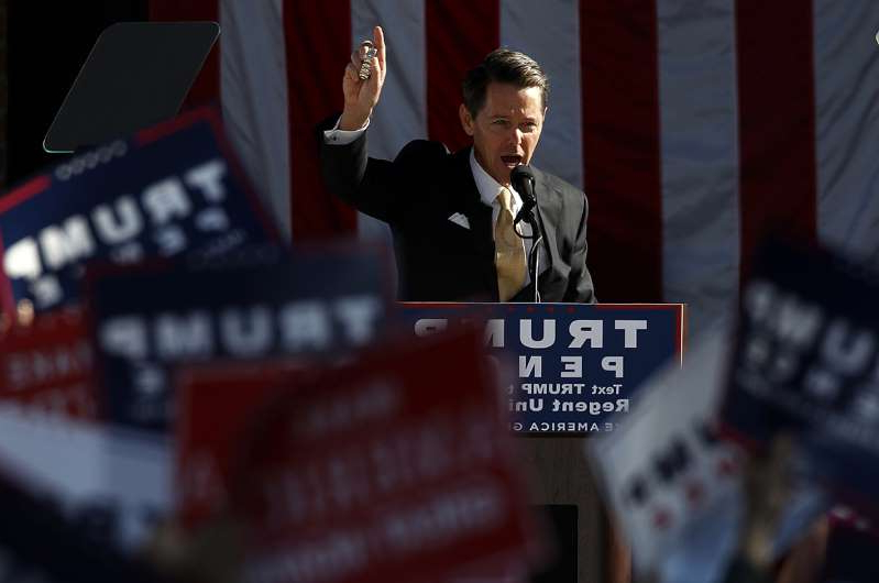 Ralph Reed holding a sign: Faith and Freedom Coalition founder Ralph Reed.