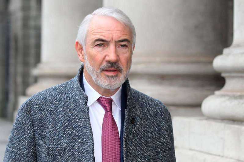 Sean Dunne wearing a suit and tie: Bankruptcy: Businessman Seán Dunne had debts of €700m in 2013. Photo: Collins Courts