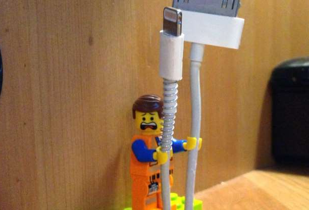 Slide 10 of 55: LEGO mini-figs are perfectly shaped to hold your Apple lightning cords and other cables. Just stick a LEGO brick on your work desk, then attach a mini-fig, and run your cords through its hands. Yeah, you can thank us later.