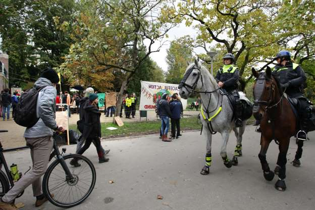 Slide 11 of 52: Dutch mounted police patrol next the Extinction Rebellion Climate activists group set up a so-called climate camp at the Vondelpark on October 8, 2019 in Amsterdam,Netherlands. (