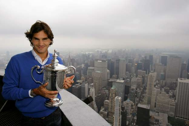 Slide 6 of 16: NEW YORK - SEPTEMBER 09:  Roger Federer the 2008 US Open Tennis Champion poses with his trophy on a viewing deck at the Empire State Building on September 9, 2008 in New York City.  (Photo by Chris Trotman/Getty Images for the USTA)