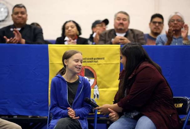 Slide 6 of 52: Climate change environmental activist Greta Thunberg joins Red Cloud Indian School student and activist Tokata Iron Eyes at a youth panel at the Standing Rock Indian Reservation, North Dakota, U.S. October 8, 2019.