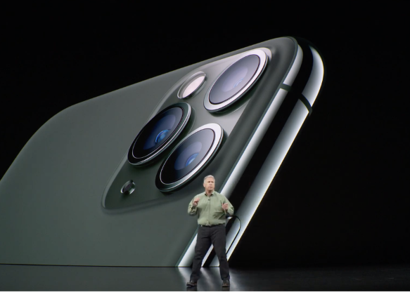 a close up of a person: The Pro phones come in midnight green, space gray, silver and gold.