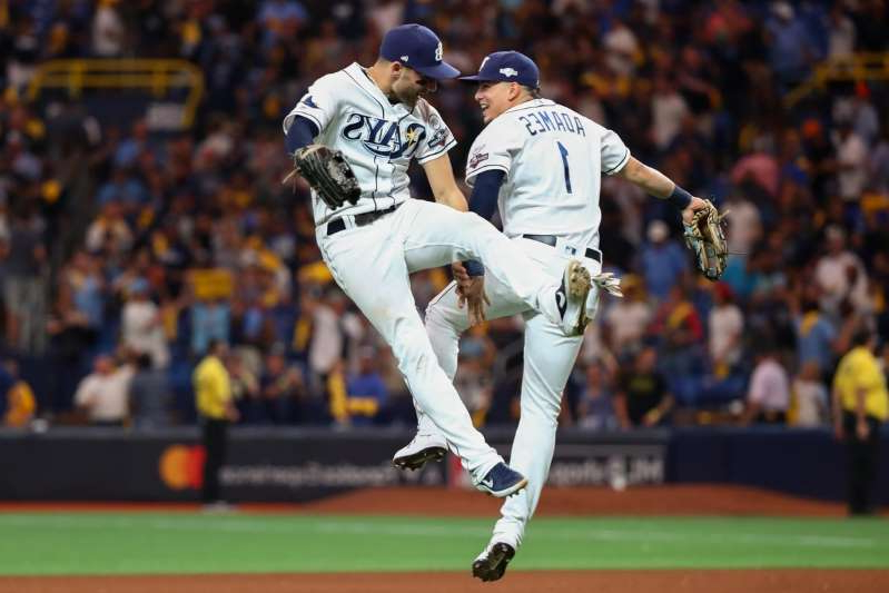 a crowd of people watching a baseball game: Tampa Bay Rays shortstop Willy Adames (1) and center fielder Kevin Kiermaier (39) celebrate their win over the Houston Astros during the ninth inning in game four of the 2019 ALDS playoff baseball series at Tropicana Field on October 8, 2019.
