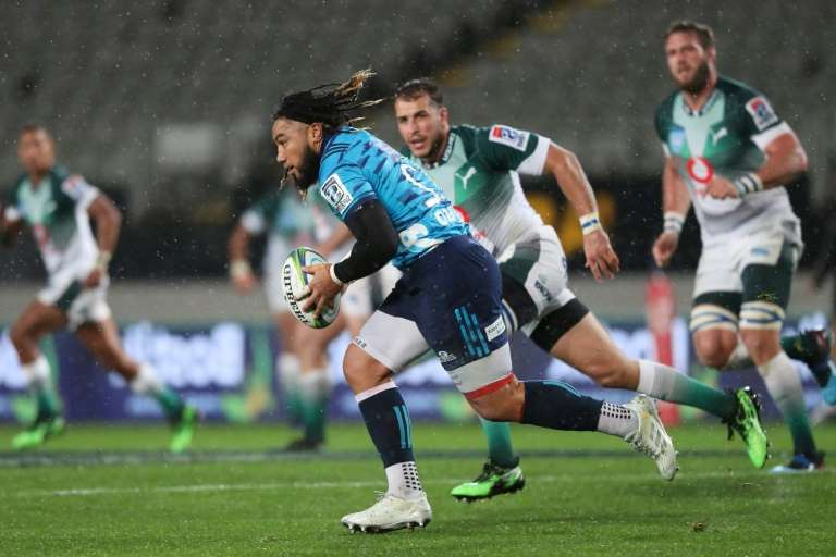 a group of people playing football on a field: Ma'a Nonu, running with the ball for the Auckland Blues in a Super Rugby match, has signed with the San Diego Legion of Major League Rugby, the North American circuit announced Wednesday