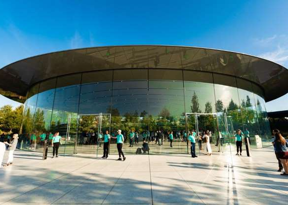 a group of people standing in front of Mercedes-Benz Superdome: Live from the Steve Jobs Theater on Apple's campus in Cupertino, California, Apple on Tuesday launched the iPhone 11 and iPhone 11 Pro.