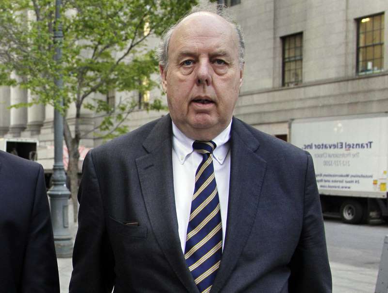 a man wearing a suit and tie: Attorney John Dowd, here seen in New York in April 2011, used the font Comic Sans this week in a letter to members of a House committee, drawing jokes and criticism. Dowd responded, saying,