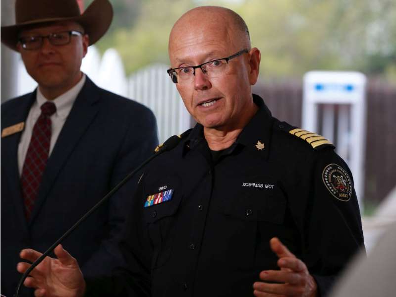 a man wearing a uniform: Calgary Emergency Management Agency Chief Tom Sampson speaks to the media in this July 2018 file photo.