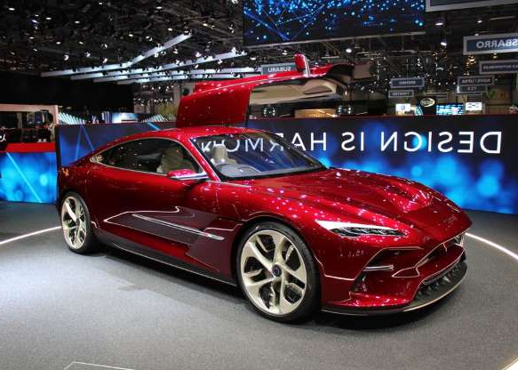 a red car on display: It's an all-electric concept, though Italdesign says the car is designed to also be able to accommodate a gasoline engine.