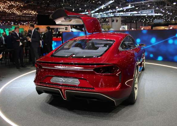 a red car parked on the side of a road: The four-seat cabin has lots of Alcantara trim.