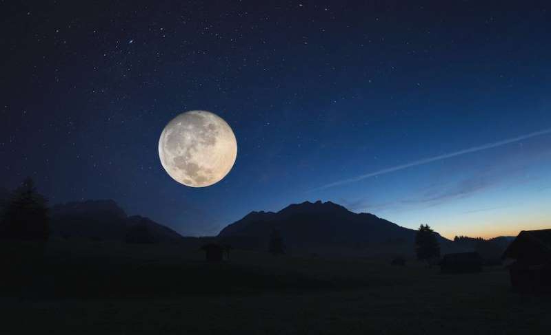 a sky with a mountain in the background: Full moon effects on sleep are real and research-supported