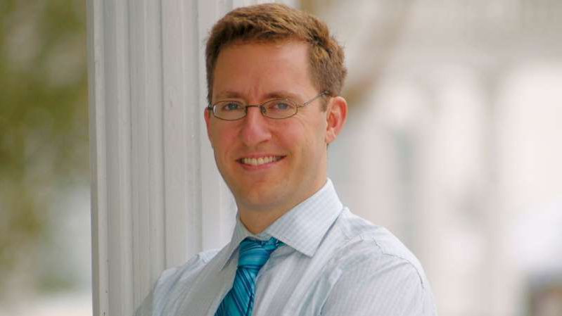 Dan Markel wearing a suit and tie smiling at the camera: Police are trying to find the person who killed Florida State University law professor Dan Markel, 41.