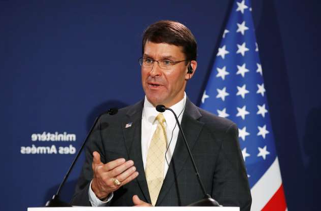 Ioan Sabău wearing a suit and tie: U.S. Defense Secretary Mark Esper holds a news conference with French Defense Minister Florence Parly at the residence of French Defense Minister in Paris