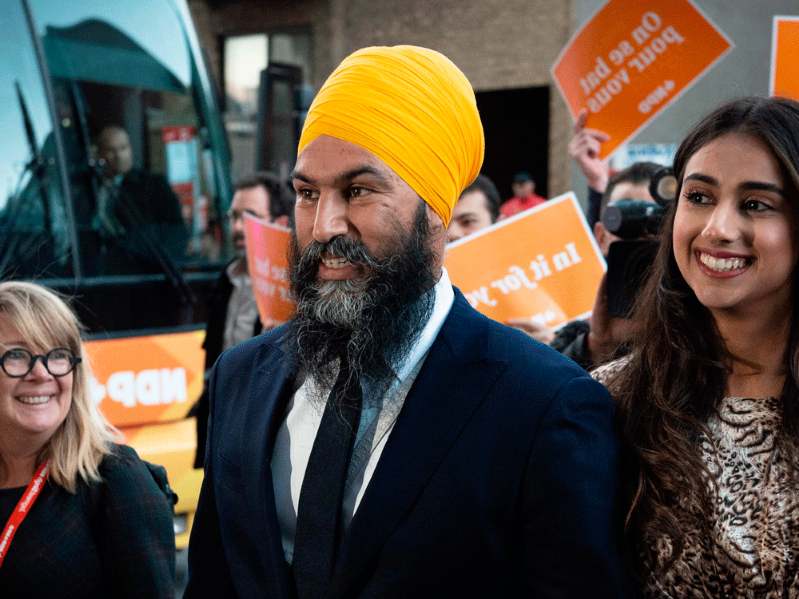 Jagmeet Singh et al. standing in front of a store: NDP Leader Jagmeet Singh arrives in Montreal for a French-language debate, Oct. 2, 2019.
