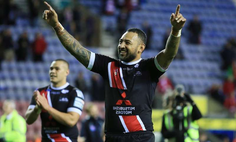 Krisnan Inu playing a game of football: Krisnan Inu celebrates Salford's win over Wigan Warriors in the play-off semi-final.