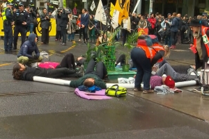 Major CBDs brought to standstill as protestors chained to streets