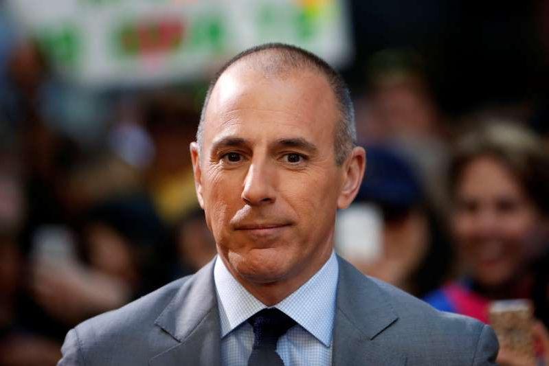 Matt Lauer wearing a suit and tie: Matt Lauer seen May 3, 2013.