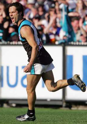 Slide 11 of 26: MELBOURNE, AUSTRALIA - SEPTEMBER 25:  Gavin Wanganeen #4 for Port Adelaide in action during the AFL Grand Final between the Port Adelaide Power and the Brisbane Lions at the Melbourne Cricket Ground September 25, 2004 in Melbourne, Australia. (Photo by Sean Garnsworthy/Getty Images)