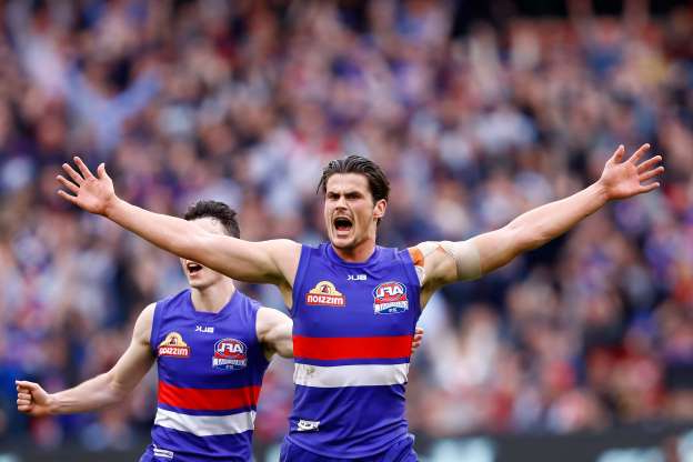 Slide 2 of 26: MELBOURNE, VICTORIA - OCTOBER 01:  Tom Boyd of the Bulldogs celebrates a goal during the 2016 AFL Grand Final match between the Sydney Swans and the Western Bulldogs at Melbourne Cricket Ground on October 1, 2016 in Melbourne, Australia.  (Photo by Darrian Traynor/AFL Media/Getty Images)