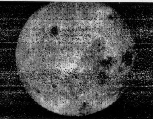 Slide 5 of 43: The first image returned by Luna 3 showed the far side of the Moon was very different from the near side, most noticeably in its lack of lunar maria (the dark areas) The Luna 3 spacecraft returned the first views ever of the far side of the Moon. The first image was taken at 03:30 UT on 7 October at a distance of 63,500 km after Luna 3 had passed the Moon and looked back at the sunlit far side. The last image was taken 40 minutes later from 66,700 km. A total of 29 photographs were taken, covering 70% of the far side. The photographs were very noisy and of low resolution, but many features could be recognized. This is the first image returned by Luna 3, taken by the wide-angle lens, it showed the far side of the Moon was very different from the near side, most noticeably in its lack of lunar maria (the dark areas). The right three-quarters of the disk are the far side. The dark spot at upper right is Mare Moscoviense, the dark area at lower left is Mare Smythii. The small dark circle at lower right with the white dot in the center is the crater Tsiolkovskiy and its central peak. The Moon is 3475 km in diameter and north is up in this image. (Luna 3-1, Russian Space Agency, not necessarily in the public domain)