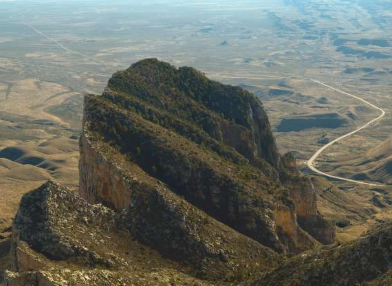 Slide 6 of 17: XX-Large Aerial view (from top of Guadalupe Peak) of El Capitan, the spectacular ancient reef at the southern end of the Guadalupe Mountains in West Texas. To see all my Guadalupe Mountains and Carlsbad Caverns photos, click here