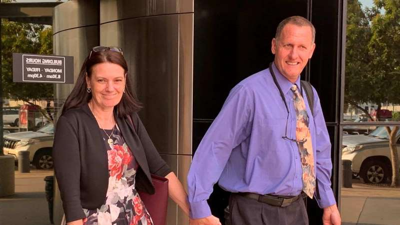a couple of people that are standing in the street: Principal Tracey Brose leaves the District Court at Southport with her husband. (ABC Gold Coast: Gemma Sapwell)