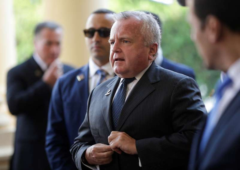 John J. Sullivan wearing a suit and tie: Deputy Secretary of State John J. Sullivan arrives at the Lopez Palace in Asuncion.