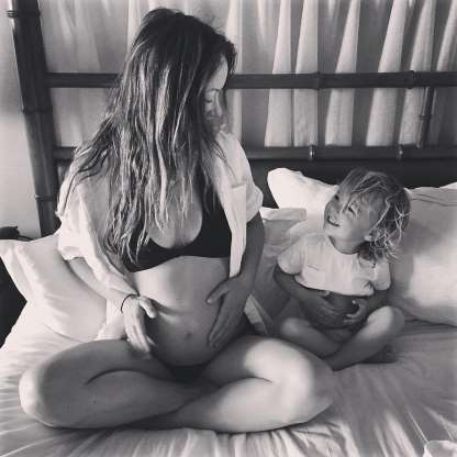 "Slide 36 of 47: The actress announced her second child with a super cute photo on Instagram. ""Matching baby bumps,"" she captioned an adorable snap of herself in a bikini with her son, Otis, patting their protruding bellies."