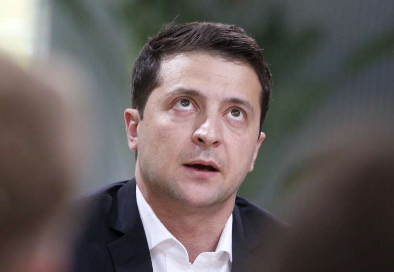 Ukrainian President Volodymyr Zelenskiy speaks during talks with journalists in Kyiv, Ukraine, Thursday, Oct. 10, 2019. Ukrainian President is holding an all-day