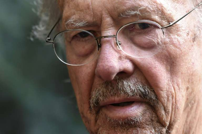 a close up of a man wearing glasses and looking at the camera: Austrian writer Peter Handke's Nobel literature prize win has irked the Balkans, while voices beyond the region spoke out against honouring an admirer of late Serbian strongman Slobodan Milosevic; Handke is pictured October 10, 2019