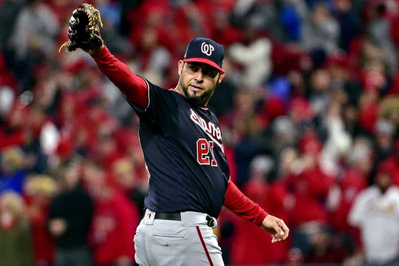 a man in a baseball uniform throwing a ball: Washington Nationals starting pitcher Anibal Sanchez (19) reacts as he is pulled from the game during the eighth inning against the St. Louis Cardinals in game one of the 2019 NLCS playoff baseball series at Busch Stadium on October 11, 2019.