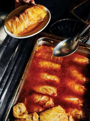 a pan filled with food: Get the recipe for Cabbage Rolls with Beef and Rice »