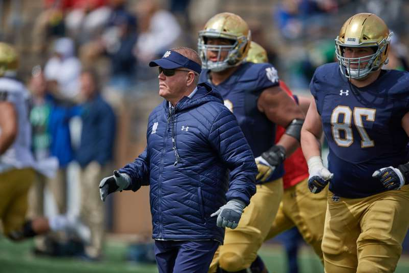 a baseball player wearing a helmet: Brian Kelly probably should have received a flag here. (Photo by Robin Alam/Icon Sportswire via Getty Images)