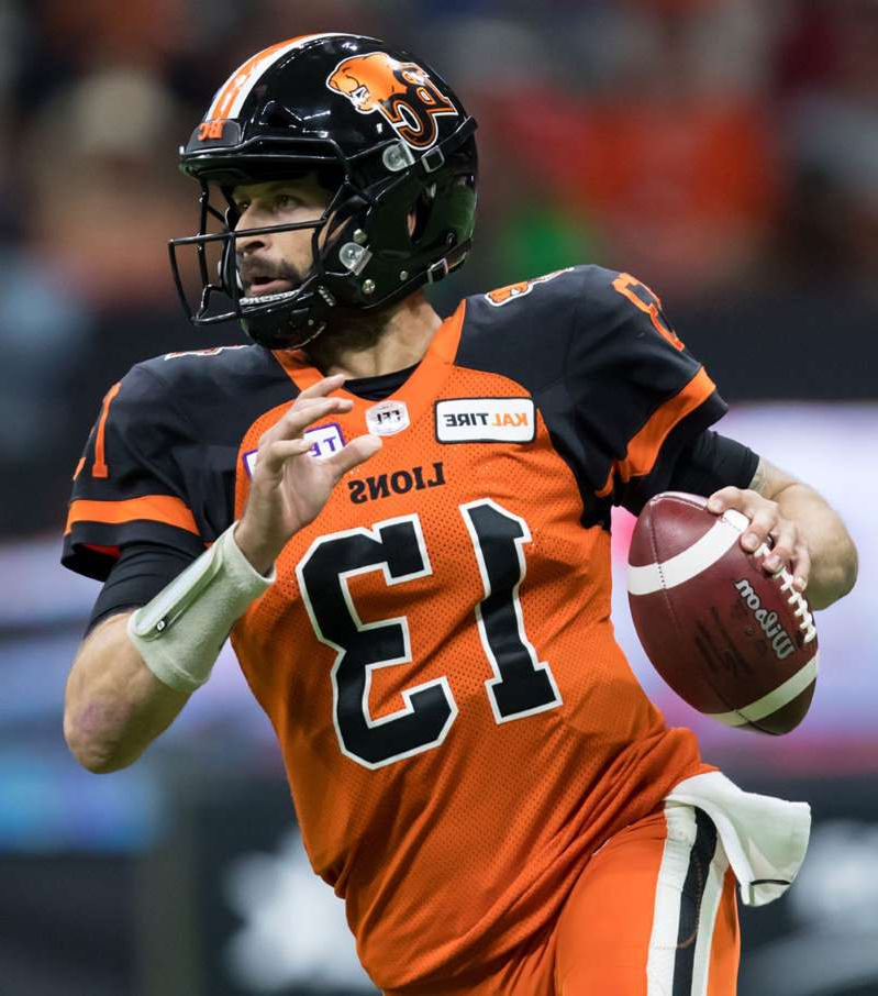 a close up of a baseball player holding a bat: B.C. Lions quarterback Mike Reilly, a former star pivot with the Eskimos, was removed from Saturday's must-win game in Edmonton after the first series with a wrist injury.