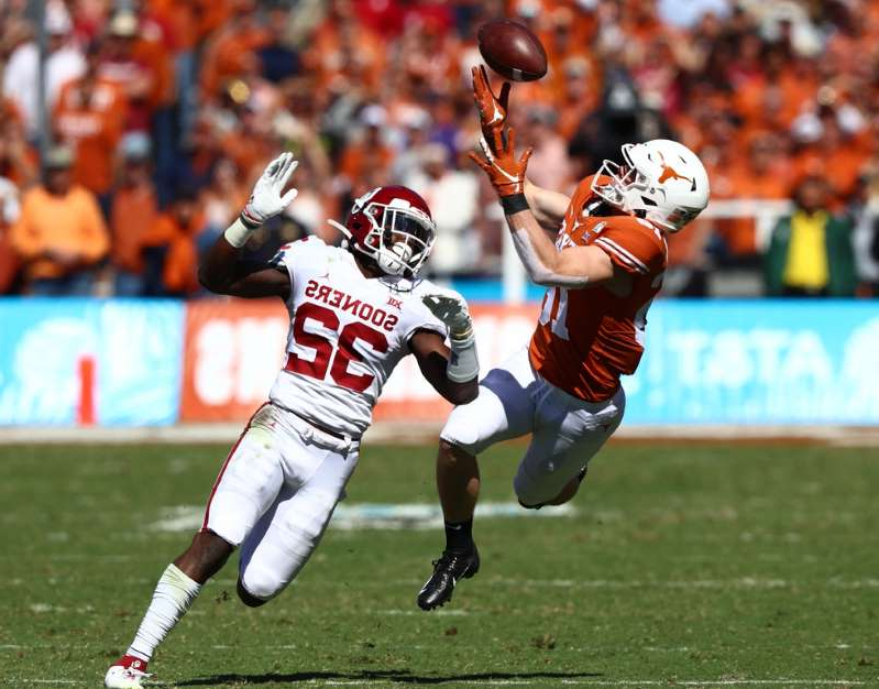 a football player on the field: Texas Longhorns receiver Jake Smith (16) can not make the catch in the second quarter against Oklahoma Sooners safety Delarrin Turner (32) at the Cotton Bowl on October 12, 2019.