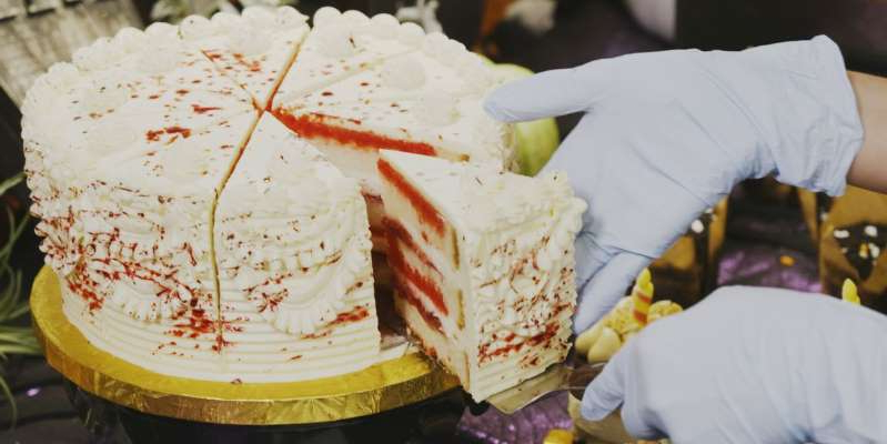a piece of cake on a plate: Disneyland's Central Bakery is busy whipping up Halloween desserts for the whole park, from sweet potato hand pies to Coco cakes and Haunted Mansion wedding cakes.