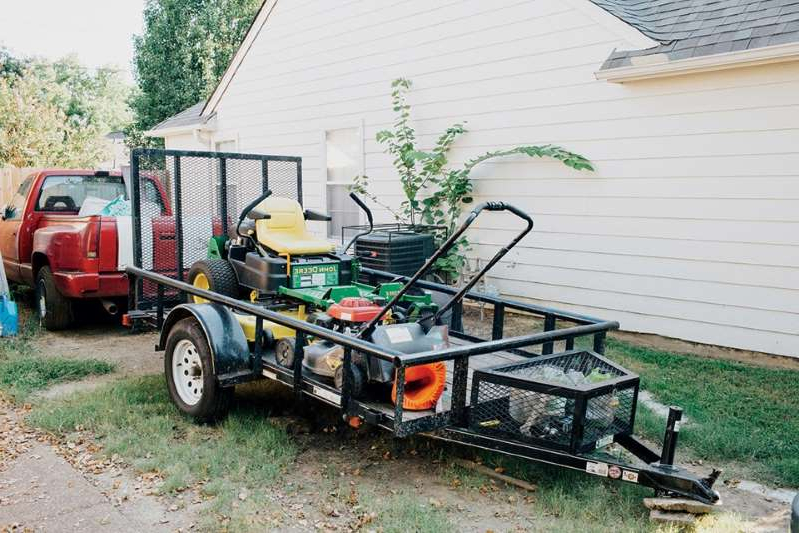 a truck is parked in front of a house: Chauncy has started a landscaping business, but he feels stuck in Memphis, unsure how to reach for something more. (Akasha Rabut)