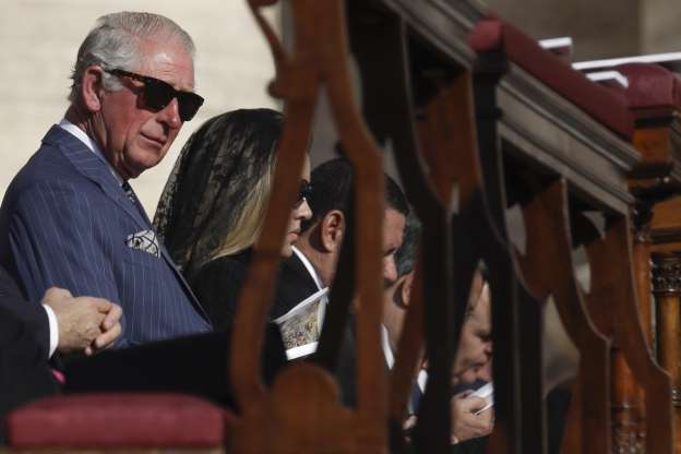 Britain's Prince Charles attends a canonization Mass in St. Peter's Square at the Vatican, Sunday, Oct. 13, 2019. Pope Francis canonizes Cardinal John Henry Newman, the 19th century Anglican convert who became an immensely influential thinker in both Anglican and Catholic churches, and four other women. (AP Photo/Alessandra Tarantino)