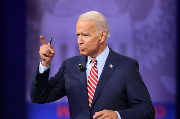 Joe Biden wearing a suit and tie: Democratic White House hopeful Joe Biden is pushing back fiercely against US President Donald Trump, who has repeatedly criticized the former vice president and accused him, without evidence, of being involved in corruption in Ukraine