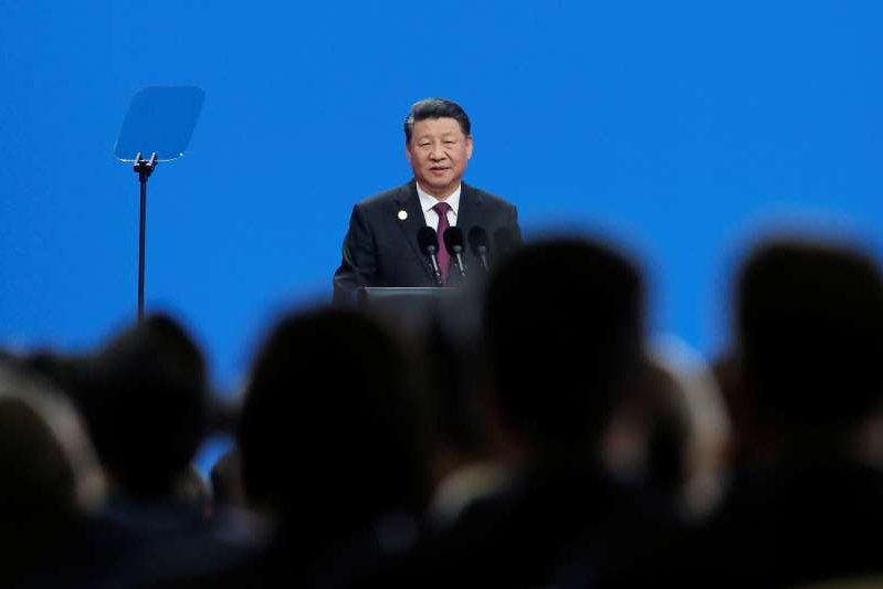 Xi Jinping in a suit standing in front of a crowd: Chinese President Xi Jinping attends the Conference on Dialogue of Asian Civilizations in Beijing