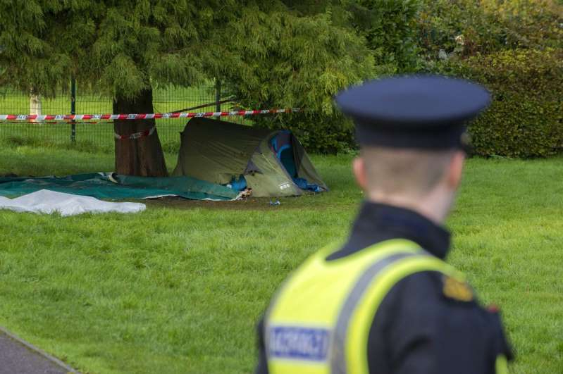 a group of people on a grass field: Cork gardaí are set to launch a murder investigation after a man died following a severe beating. (Photo: Provision)